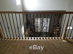 Wrought iron railing and wood hand rail for in home stair bannister